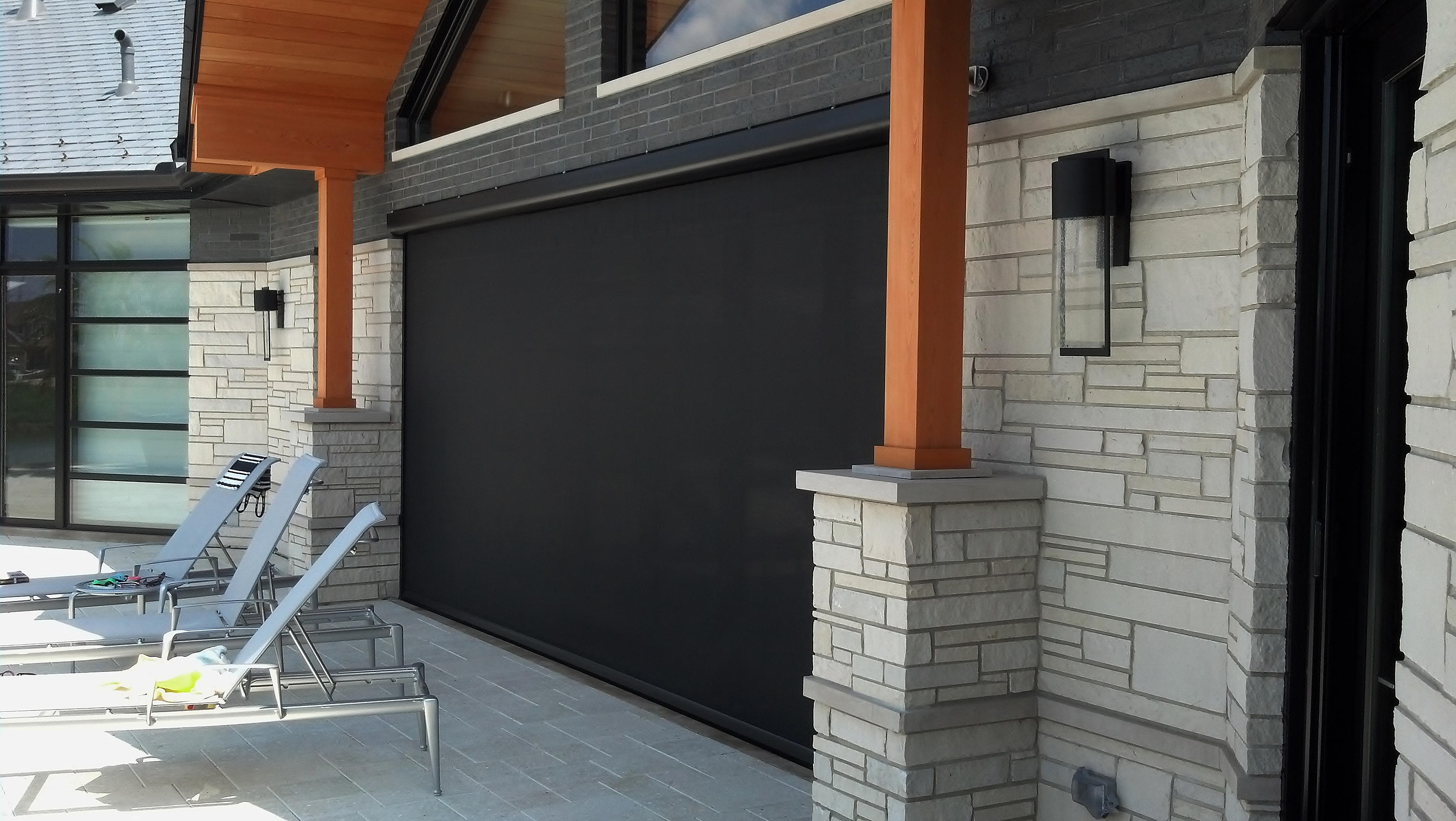 Magnatrack motorized retractable screens for patios porches for Retractable deck screens